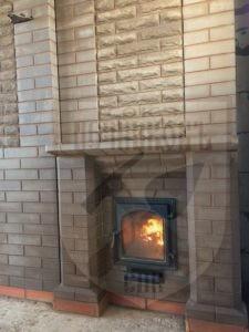 Банная печь Везувий в обкладке кирпичем